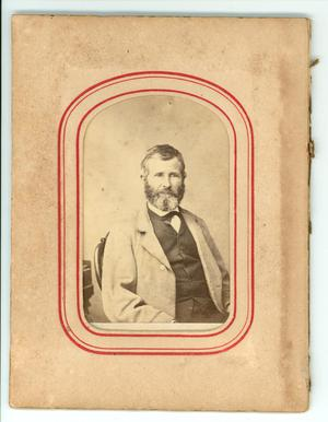 Primary view of object titled '[Photograph of a man sitting in a chair]'.
