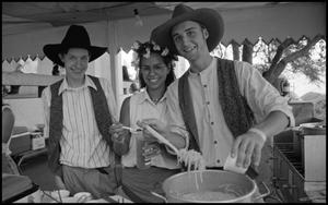 Primary view of object titled '[Serving Noodles in the Texas Wendish Heritage Society Booth]'.