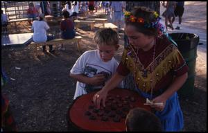 Primary view of object titled '[Playing Checkers in Frontier Playland]'.