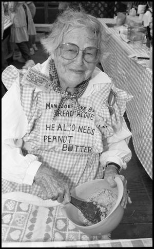 Primary view of object titled '[Ruth Higdon at the Frio County Peanut Growers Association Booth]'.