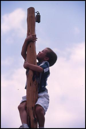 Primary view of object titled '[Boy Climbing Belgian Mast]'.