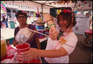 Primary view of object titled '[Aguas Frescas at the Mexican American Business and Professional Women Booth]'.