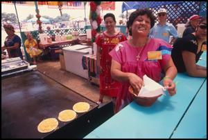 Primary view of [Woman Preparing Quesadillas]