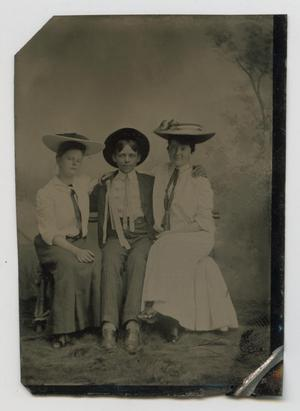 [Portrait of Two Women and a Man]