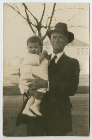 [Charles Evans, Sr. Holding a Baby]