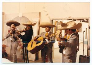 [Mariachi Band Performing]