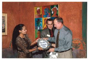 Primary view of object titled '[Sylvia Orozco, Jorge Sedeño, and Unnamed Person at Frida's Fiestas V]'.