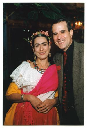 Primary view of object titled '[Jorge Sedeño and Woman Wearing Frida Kahlo Costume]'.