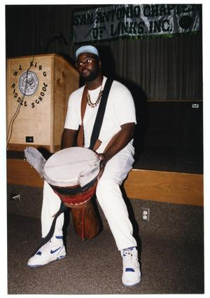 Primary view of object titled '[Adult Man with Drum at Salute to Youth Awards Program]'.