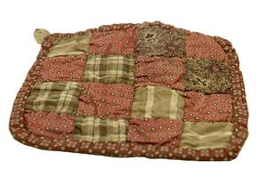 Primary view of object titled 'Quilted potholder'.