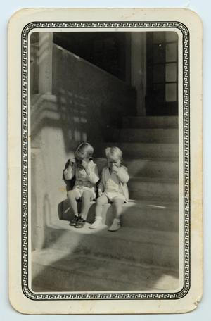 [Wendell and Walden Tarver Seated on Stairs]