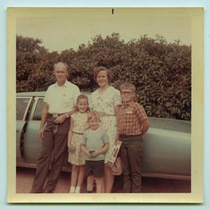 [Tarver Family Posing with Car]