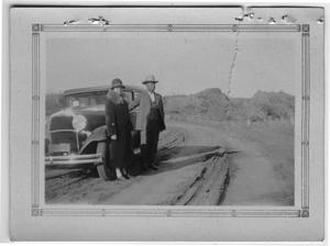 Primary view of object titled '[Sallie and Joe Griffin by an Automobile]'.