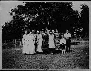 Primary view of object titled '[Falls Reunion Portrait, Family in Field]'.