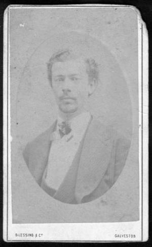 [A young man wearing a striped three-piece suit.]