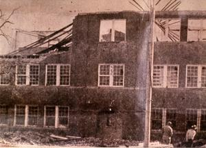 Primary view of object titled 'Brick School Building Being Torn Down'.