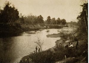 Primary view of object titled '[Photograph of People by Trinity River]'.