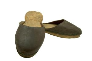Primary view of object titled 'Wooden clogs'.