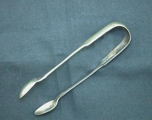 Primary view of object titled 'Sugar tongs'.