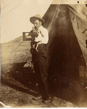 Primary view of object titled 'C. P. Schulze, Sr., Holding Fox Puppy, c. 1902'.