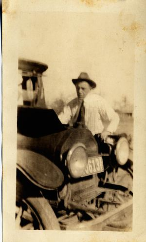 Primary view of object titled 'C. P. Schulze, Sr., by His Car'.