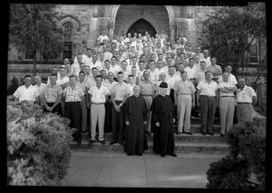 Primary view of object titled '[Men and Clergymen at St. Edward's University Retreat]'.