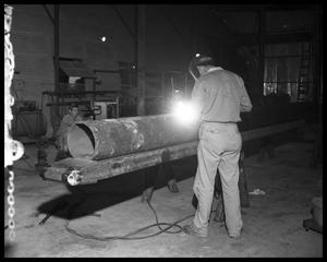 Primary view of object titled 'Men in mechanical workshop'.