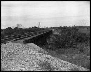 Primary view of object titled 'Inspecting main railroad trestle'.
