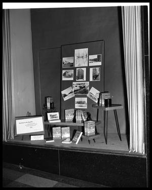 Primary view of object titled 'Scarbrough's window display of book by Dora Bonham - Merchant to the Republic'.