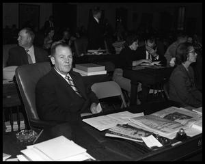Primary view of object titled 'Roy Harrington at legislature desk'.