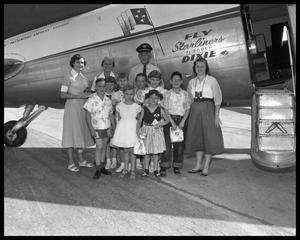 Primary view of object titled 'Kids boarding aircraft'.