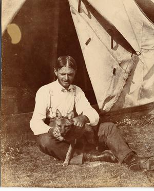 Primary view of object titled '[J. O. Shulze Playing with a Fox Puppy]'.
