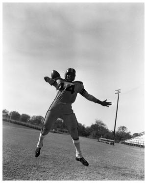 Primary view of object titled '[A Football Player Throwing a Football]'.