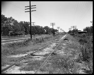 Primary view of object titled 'Train, railroad tracks and view of country'.
