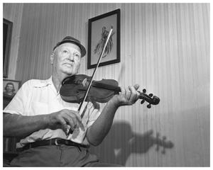 Primary view of object titled 'Man playing fiddle'.