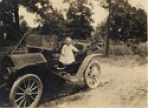Charles P. Schulze, Jr., in car, c. 1914