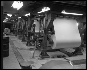 Primary view of object titled '[Rolls of paper at the Austin American-Statesman]'.