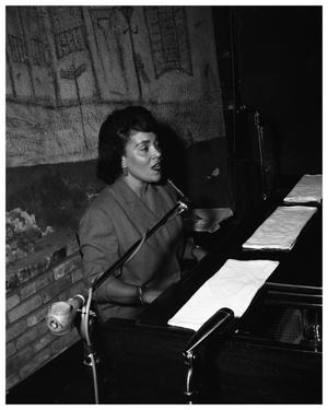 Primary view of object titled 'The New Orleans Club - exterior shot; interior shot - Ernie Mae Miller at the piano'.
