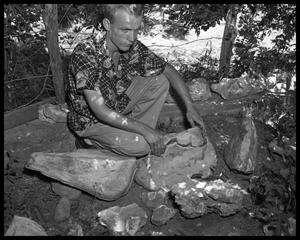 Primary view of object titled 'Man with rock collection'.