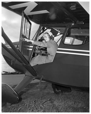 Primary view of object titled 'Woman in cockpit of airplane'.