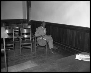 Primary view of object titled 'Young African American Talking to Reporter'.