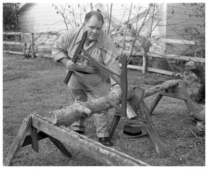 Primary view of object titled 'Man sawing wood by hand'.