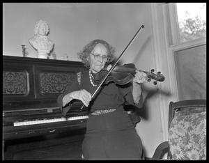 Primary view of object titled 'Woman playing violin (viola?)'.