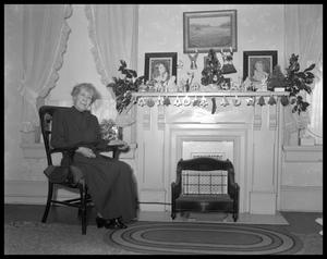 Primary view of object titled '[Mrs. Walter Bremond with Christmas decorations]'.