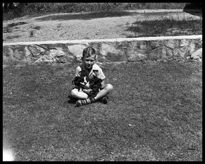 Primary view of object titled 'Buck Hood in Uniform - Child with Puppies'.