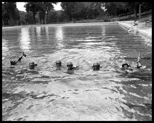 Primary view of object titled 'Soldiers from Del Valle Army Air Base training in Deep Eddy pool'.