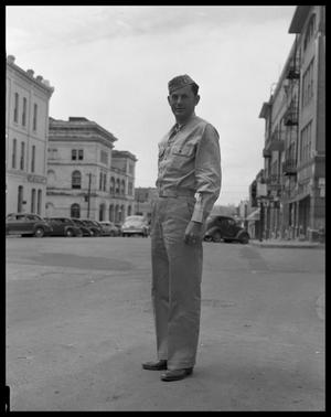Primary view of object titled 'Leemer Furr in Uniform in Street of Austin'.