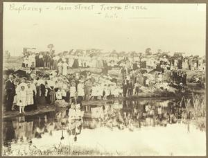 Primary view of object titled '[Baptizing in the Tierra Blanca Creek]'.