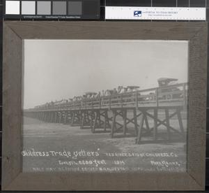 Primary view of object titled '[Childress Tradegetters Stand on the Red River Bridge]'.