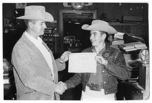 Primary view of object titled '[Former Childress County Agent Chile Smith and 4-H Member Larry Murphy]'.